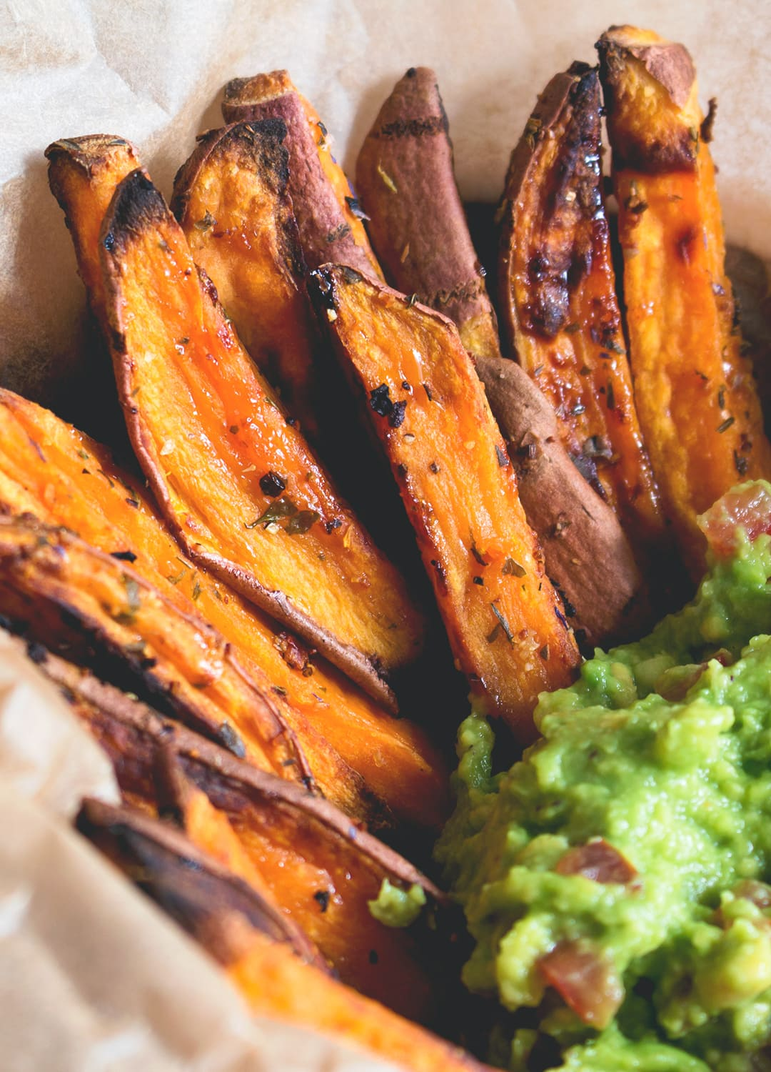 Sweet Potato Fries with Guacamole - delicious side dish, snack or main course! I love this recipe. Sweet potato fries are so delicious and actually good for you!   thehealthfulideas.com