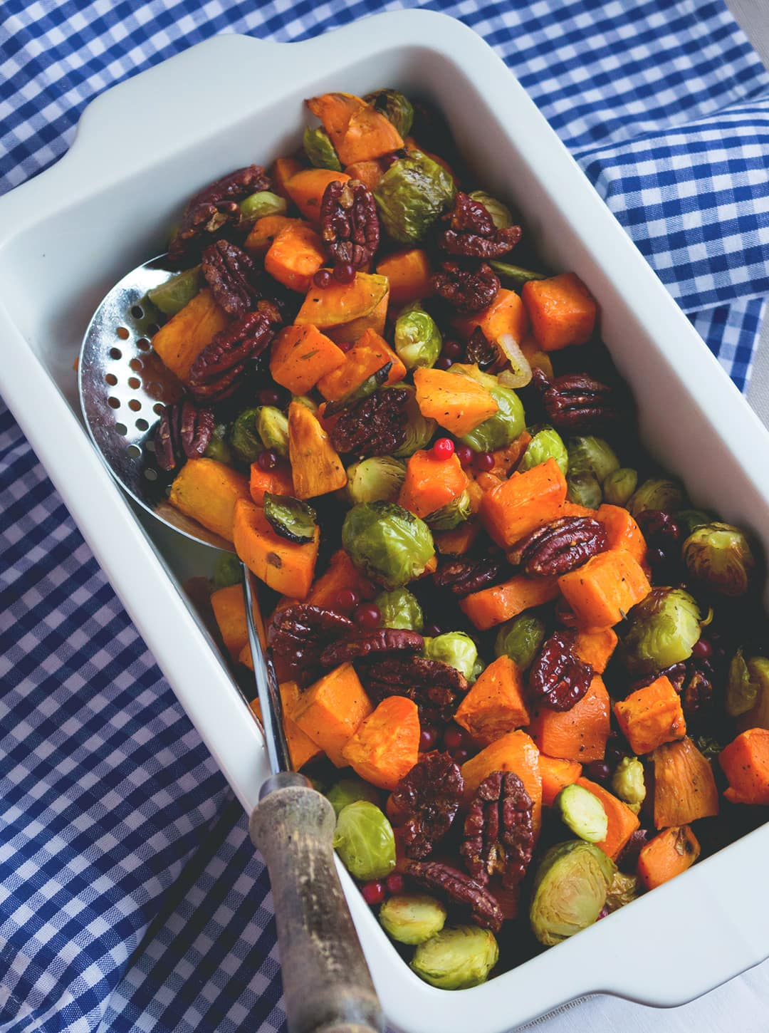 Roasted Sweet Potatoes and Brussels Sprouts with Maple Drizzle - delicious side dish, great all year round! I absolutely love this recipe. It's sweet, savory, tangy, nutty, hearty, and vegan and healthy! | thehealthfulideas.com