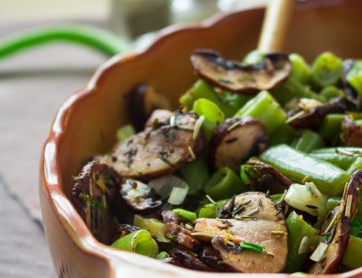Sauteed Mushrooms with Green Beans are the perfect addition to your family dinner. Savory, healthy, and full of herbs. Love serving them with roasted fish, other vegetables, or on their own. Sauteed mushrooms with green beans are the perfect addition to your family dinner. Love serving them with roasted fish or other vegetables. | thehealthfulideas.com