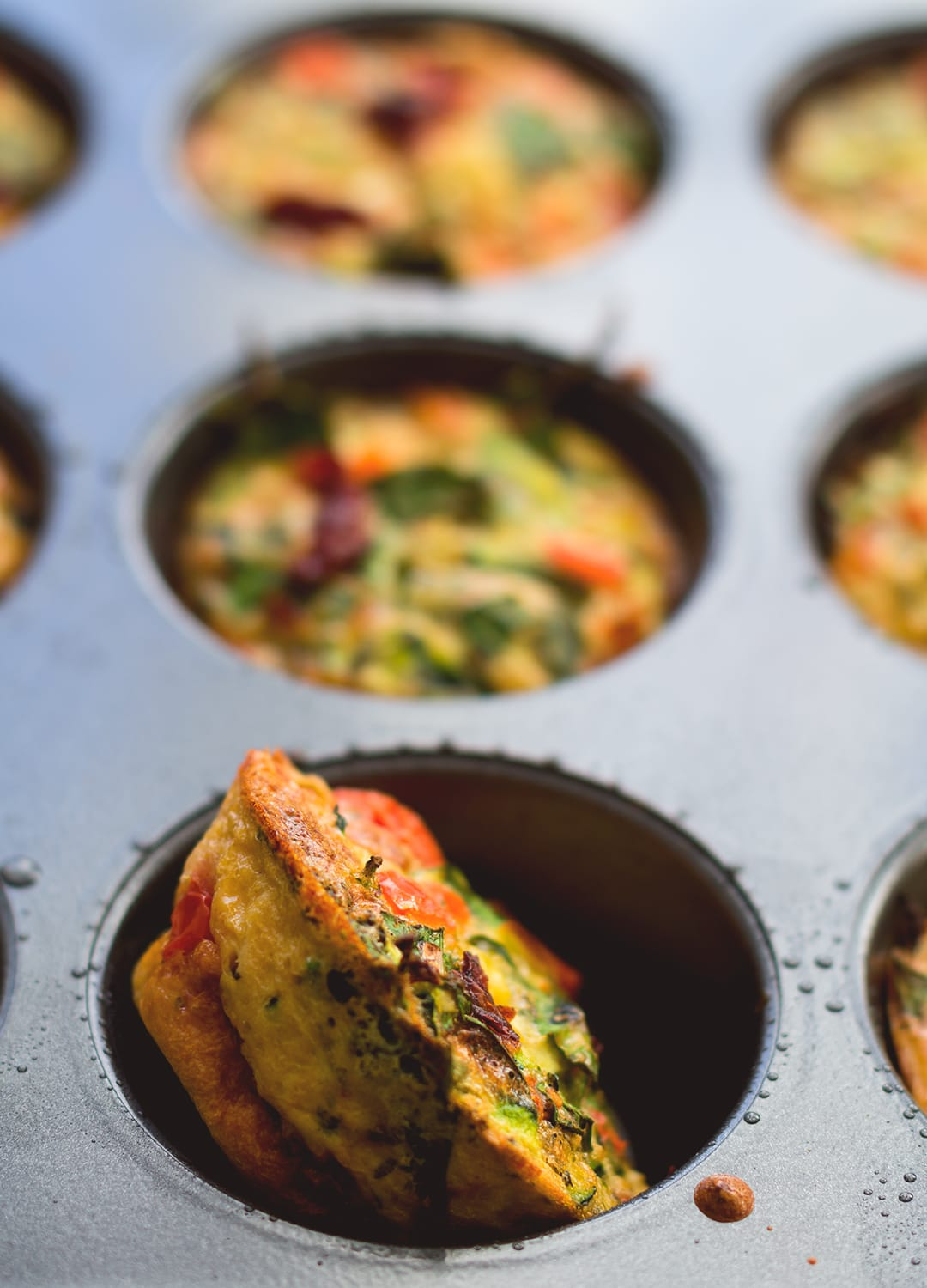 Healthy Breakfast Cheesy Egg Muffins - easy breakfast you can make ahead and eat on the go! Keep them in the fridge and add one or two to your salad for more protein! Delicious and cheesy muffins without the use of cheese - these are dairy free! | thehealthfulideas.com