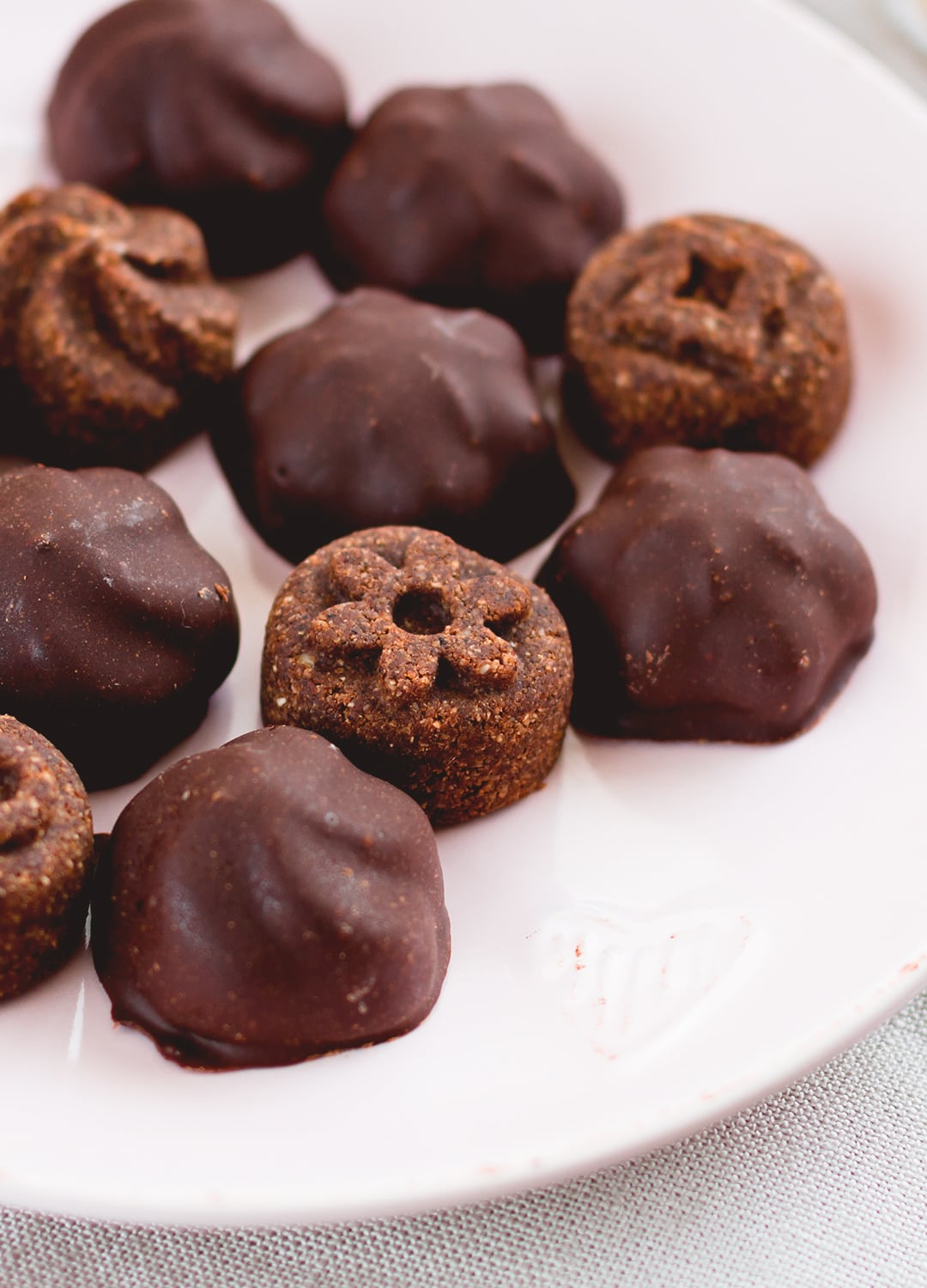 Raw Chocolate Covered Cookies - vegan and delicious, these chocolatey cookies are actually healthy! Great for Valentine's Day or any other day of the week when you're craving something sweet! Store them in the fridge or in the freezer. | thehealthfulideas.com