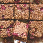 Strawberry Rhubarb Breakfast Oat Bars - delicious breakfast bars that taste totally like a dessert. You'll love this recipe. The rhubarb strawberry combination with maple syrup is divine! It tastes like marzipan!   thehealthfulideas.com
