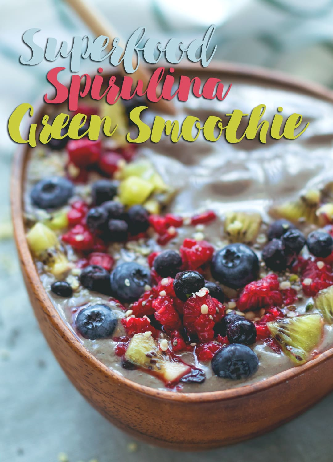 Superfood Spirulina Green Smoothie - banana, mango, raspberries, strawberries, coconut water and amazing protein packed spirulina powder. You'll love this smoothie! Easy to make, really tasty, and packed with nutrients! | thehealthfulideas.com