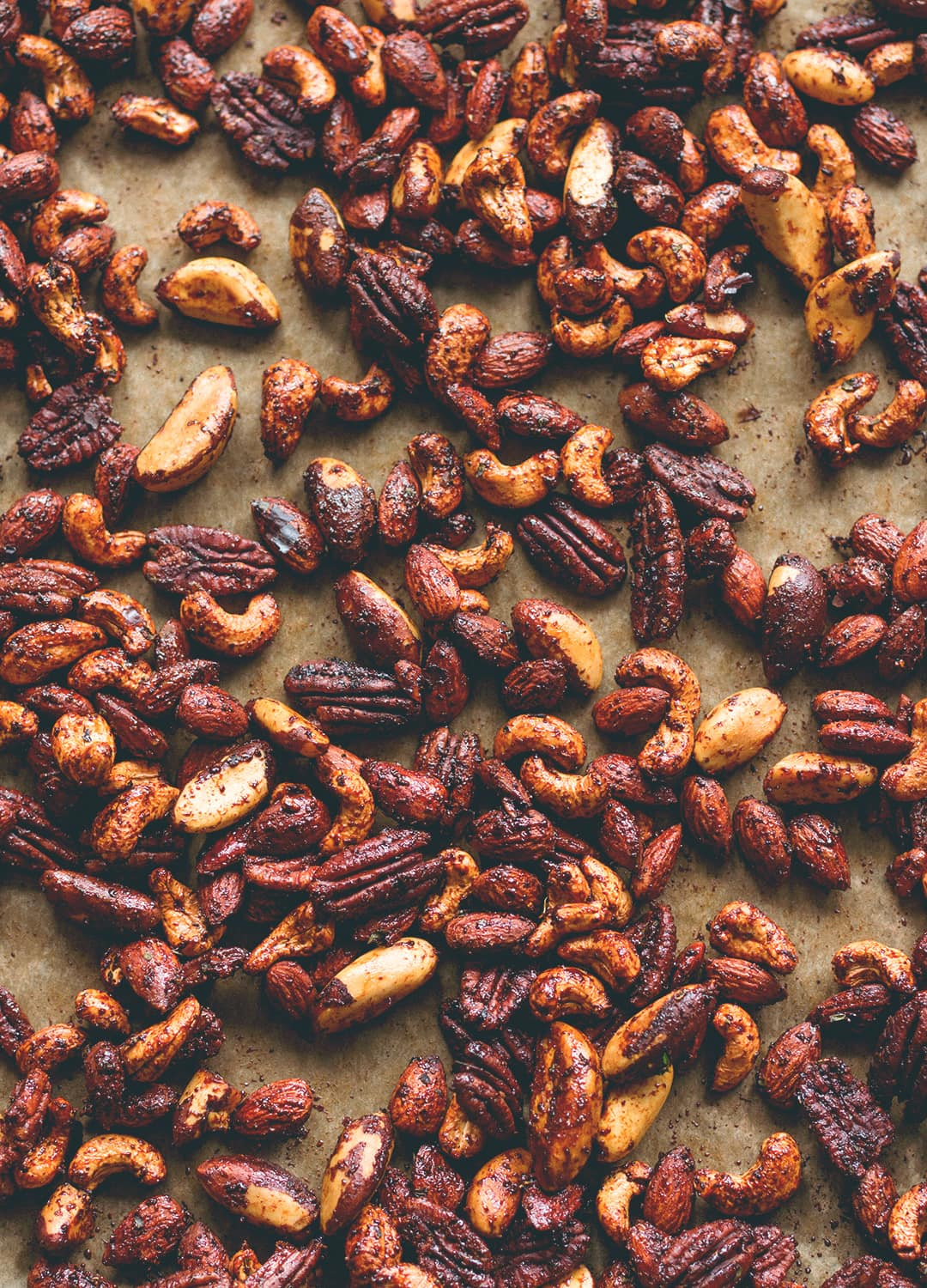 Chipotle Roasted Nuts - maple syrup, coconut oil, and spices. These are incredible! Vegan and gluten-free. | thehealthfulideas.com