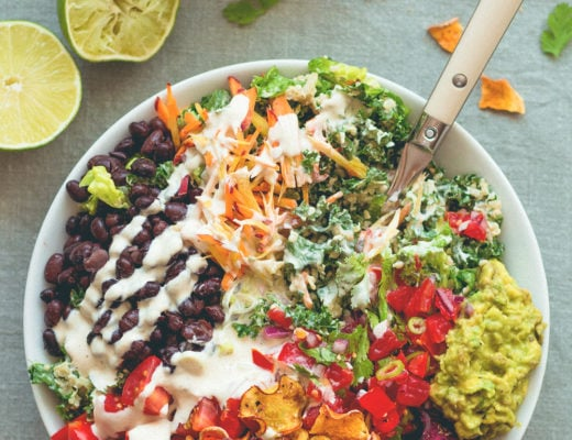Mexican Kale Salad with Cashew Dressing aka the best salad in the world. Kale, black beans, spicy salsa, guacamole, cherry tomatoes, carrots, veggie chips, and amazing cashew dressing! | thehealthfulideas.com