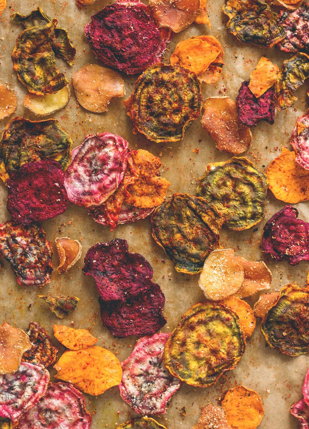 Oven Baked Veggie Chips - red, yellow, and pink beets, sweet potatoes, and some regular potatoes is all you need! Plus your favorite seasoning. You'll absolutely love these. Crunchy & delicious. | thehealthfulideas.com