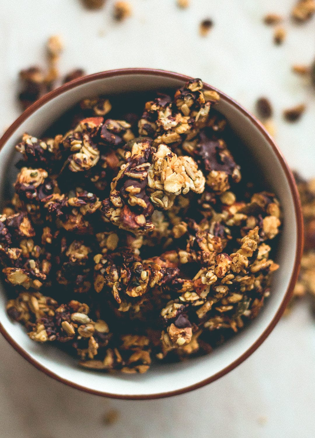 Orange Zest Granola with Dark Chocolate - delicious sweet zesty granola with melted cacao paste on top to create the best dark chocolate & orange flavor. Gluten-free, vegan, and sugar-free! You'll LOVE this granola! | thehealthfulideas.com