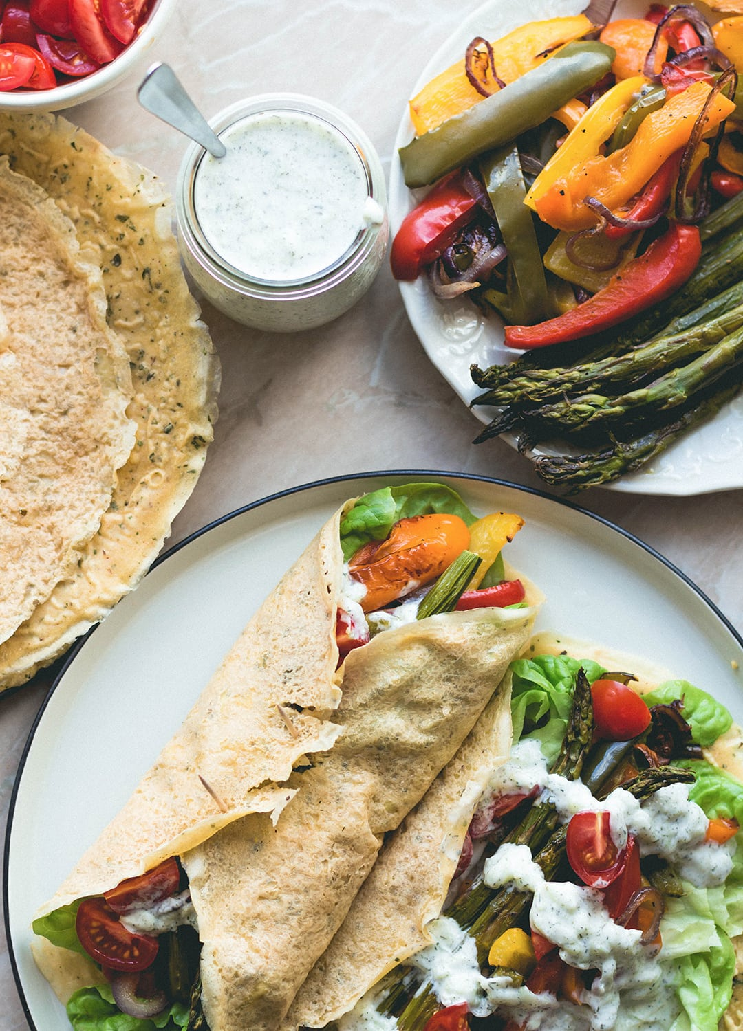 Chickpea Flour Crepes with Roasted Vegetables, fresh vegetables, and homemade sheep tzaziki! With a vegan option too! | thehealthfulideas.com