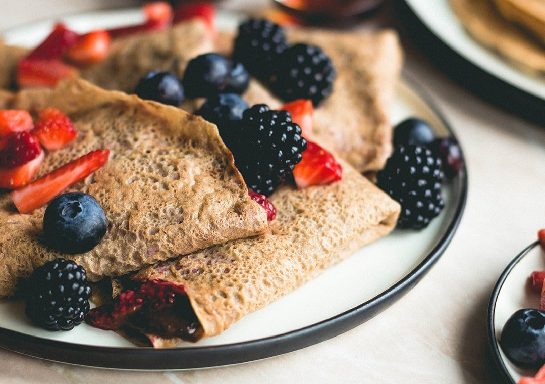 Chickpea Flour Crepes with Tahini Chocolate Sauce and Strawberry Chia Jam (vegan, gluten-free) - you won't believe these are actually vegan! SO delicious, fluffy, soft, and sweet. Brunch staple and my absolute favorite crepe recipe! | thehealthfulideas.com