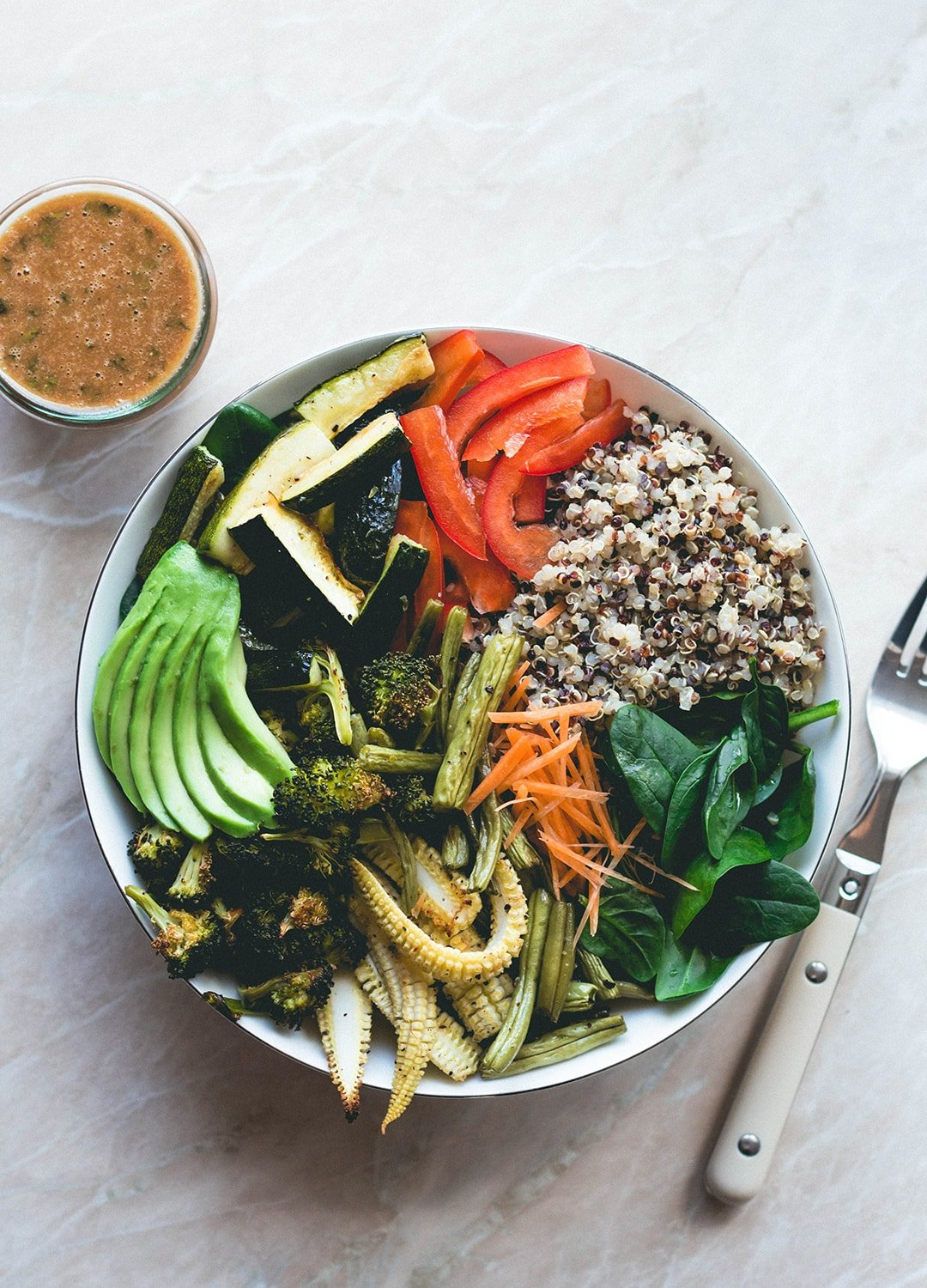 Thai Power Bowl with Wild Peanut Butter Dressing (vegan-gluten-free) - delicious salad bowl with colorful quinoa, roasted vegetables, spinach, avocado, carrots, bell peppers, and the most amazing dressing! | thehealthfulideas.com
