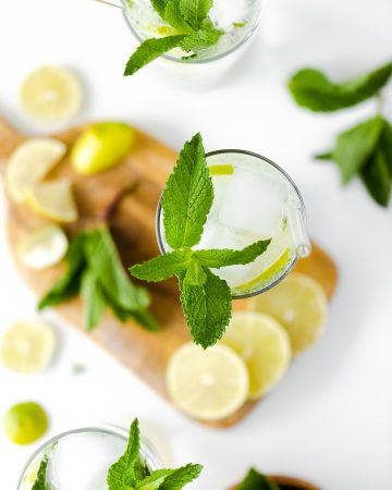 A tighter overhead shot of mojitos garnished with mint leaves