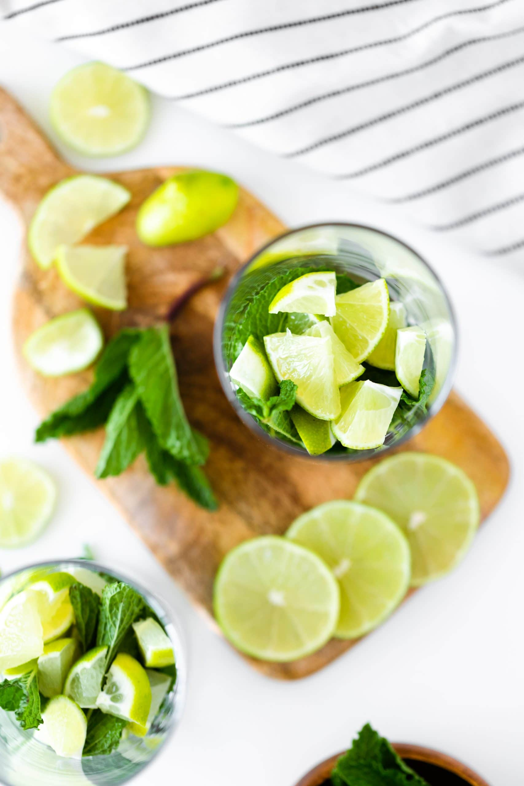 Ingredients for a mojito in a tall glass. Overhead photo