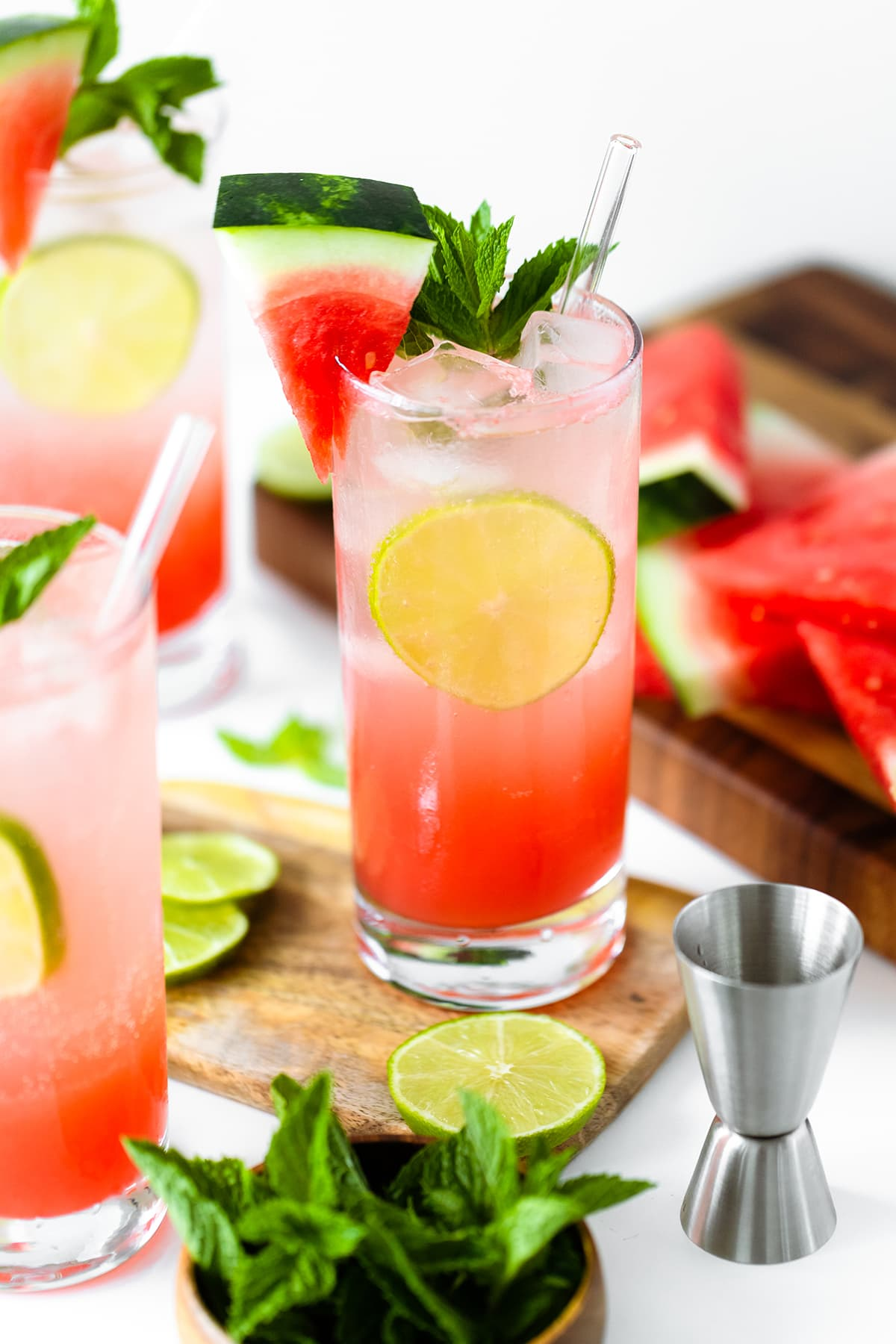 Watermelon Coconut Rum Cooler - with mint, lime, and watermelon slice