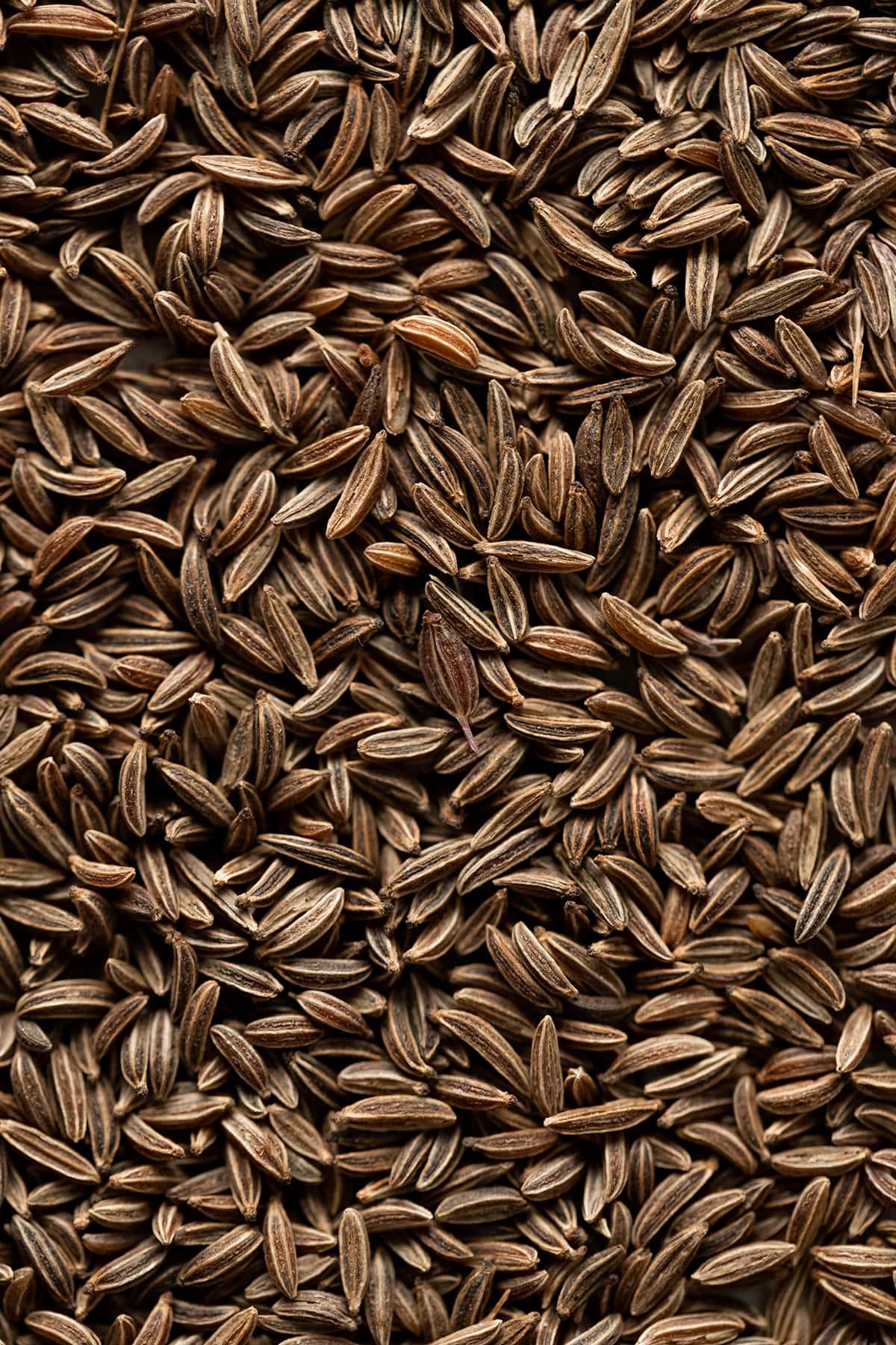 A close up photo of caraway seeds