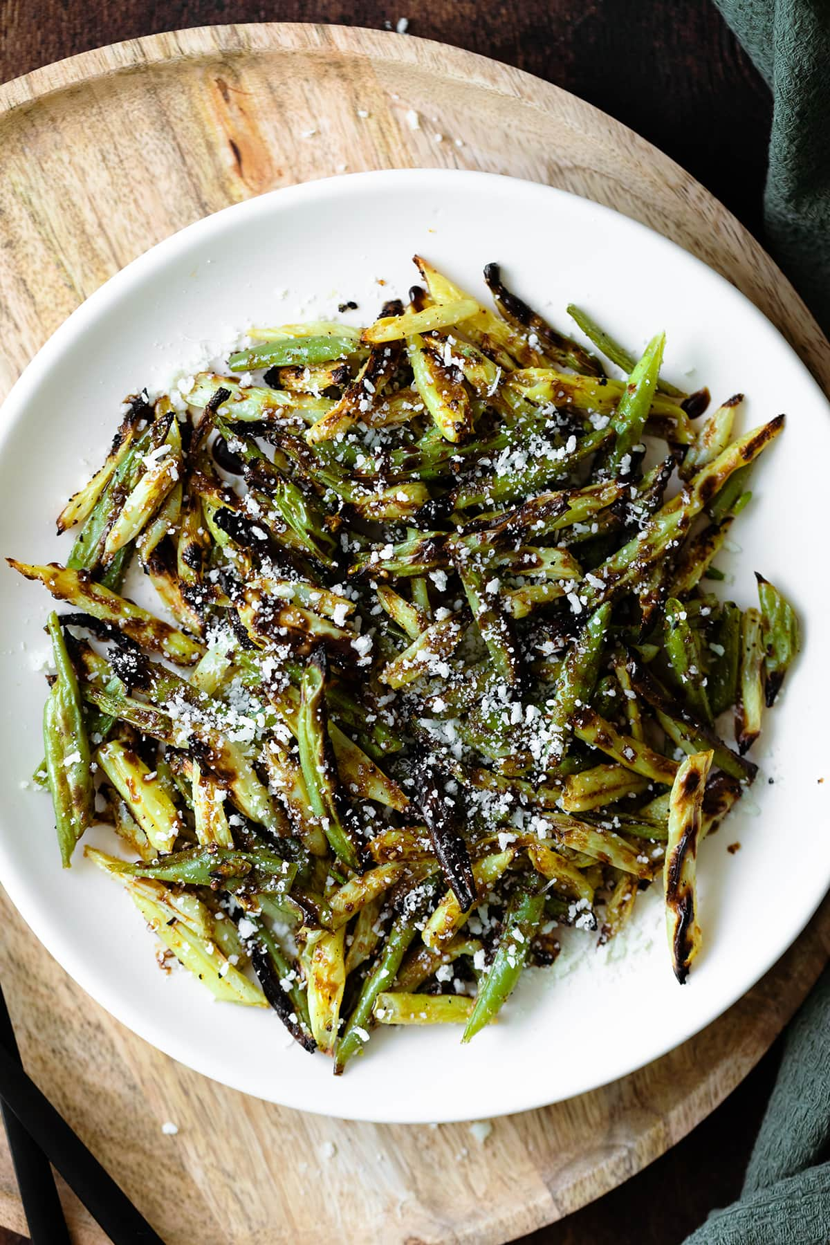 Overhead close up shot of Charred Green Beans with Pecorino Cheese