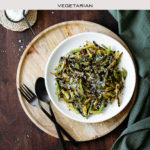 Overhead shot of Charred Green Beans with Pecorino Cheese with text