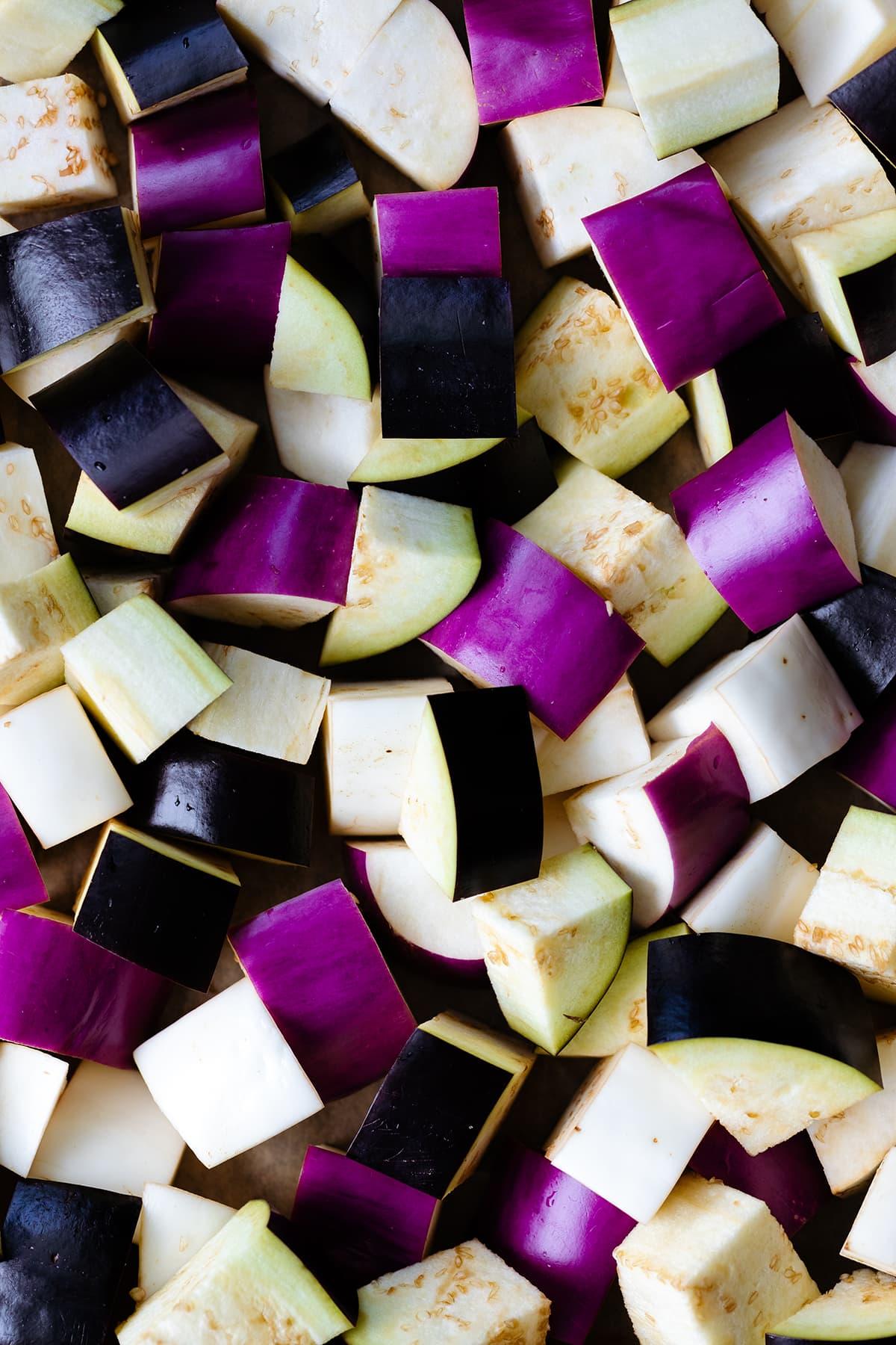 Diced eggplant (three different colors - dark purple, light purple, and white)