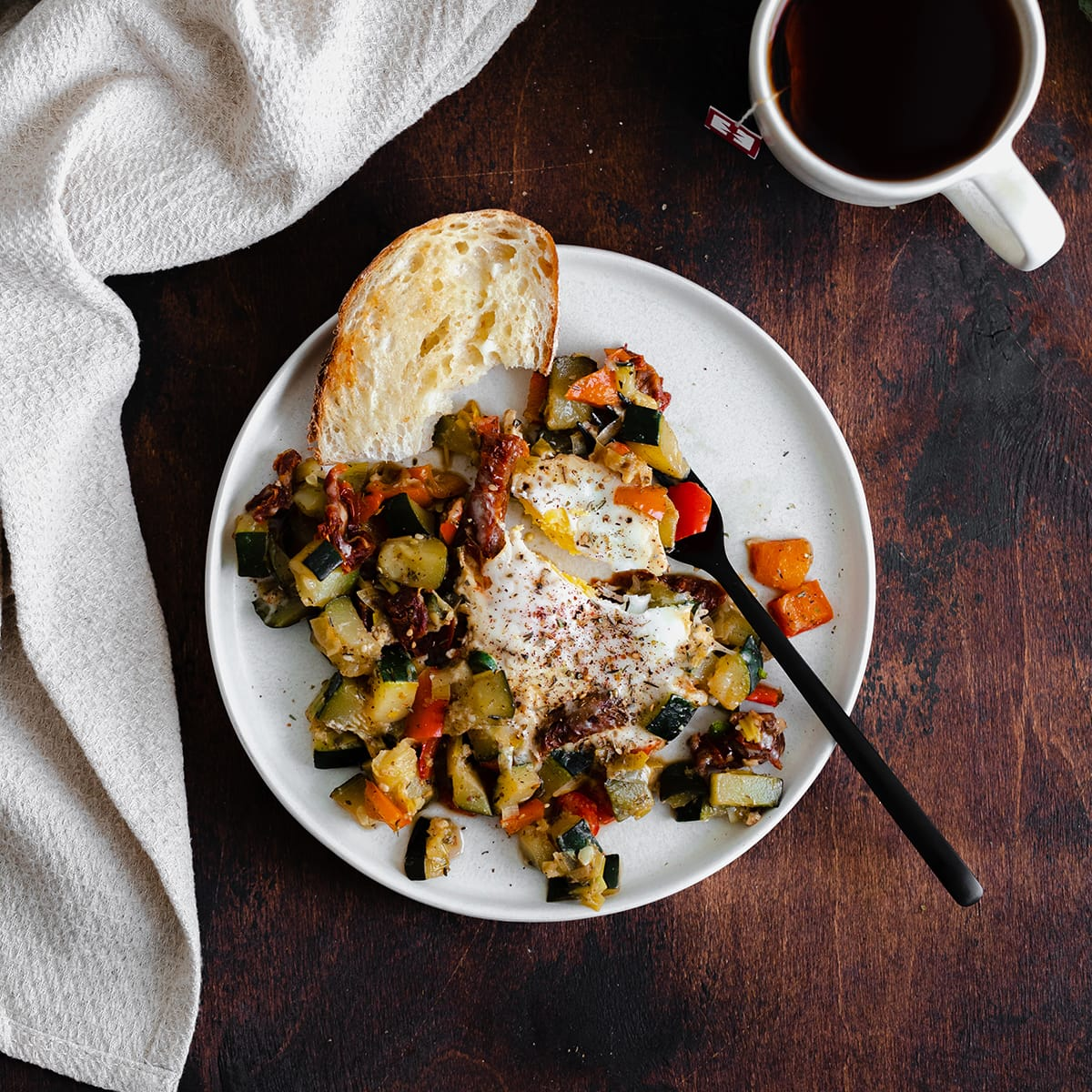 A square overhead photo of Bell Pepper and Zucchini Breakfast Skillet with Za'atar