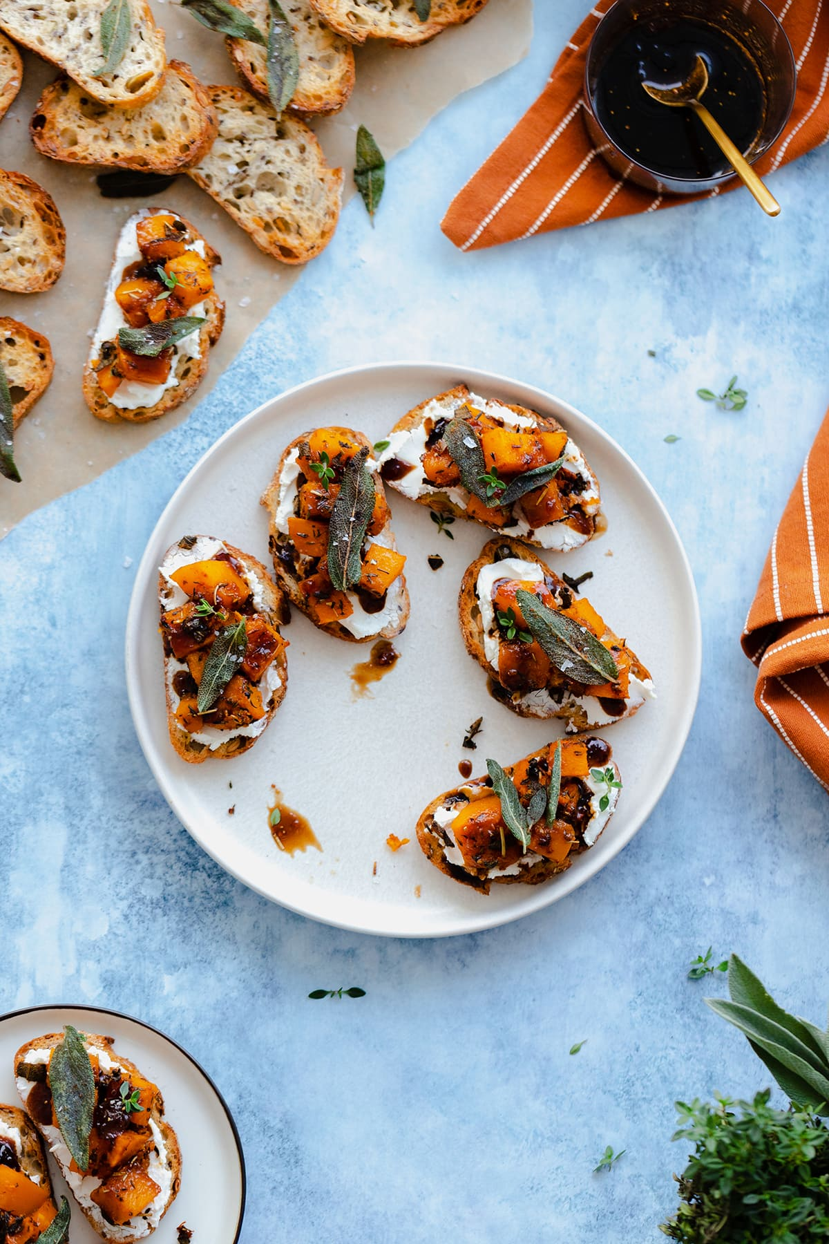 An overheat shot of Butternut Squash Crostini with Goat Cheese and Fig Balsamic Glaze