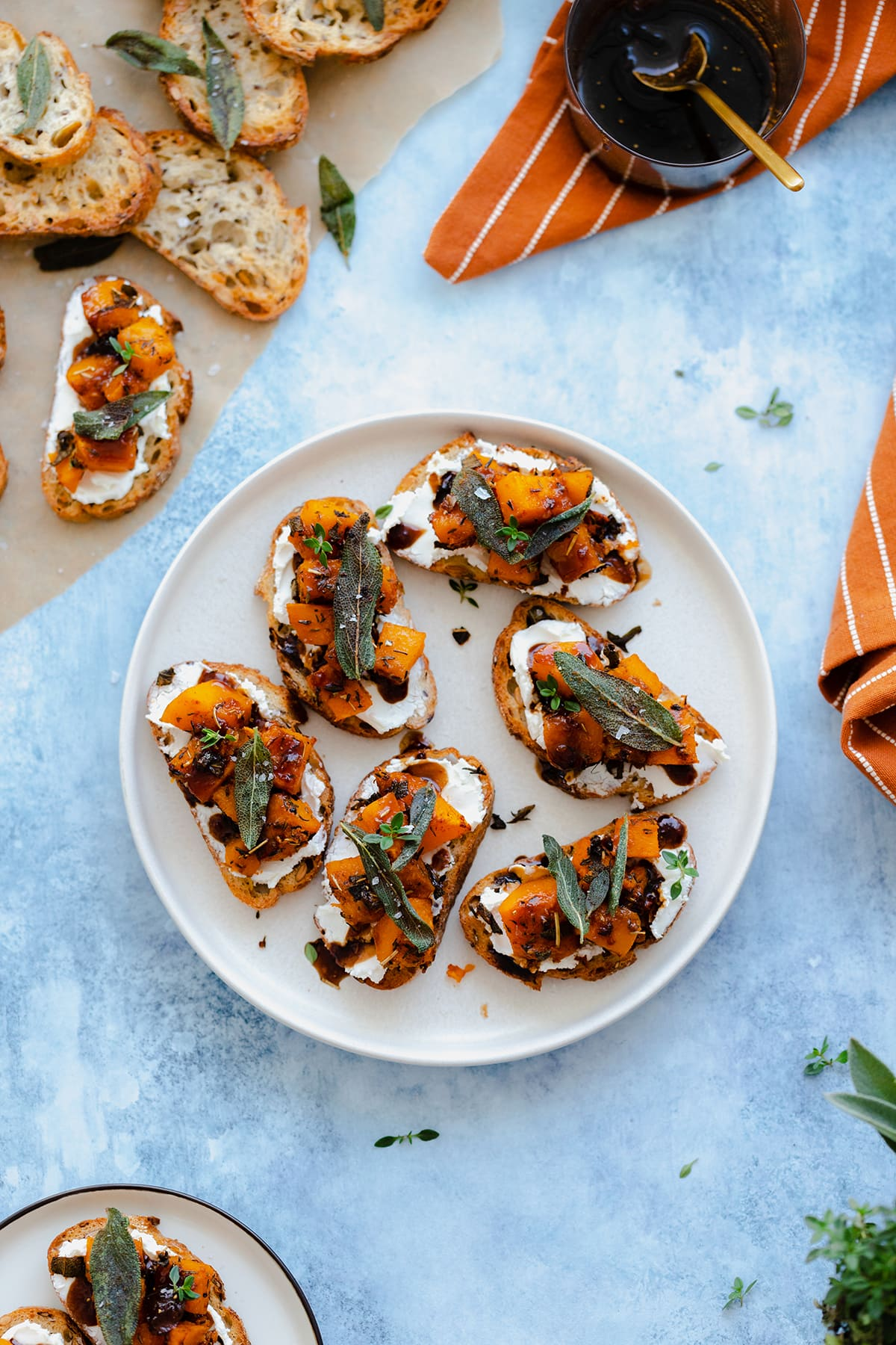 An overhead shot of Butternut Squash Crostini with Goat Cheese and Fig Balsamic Glaze