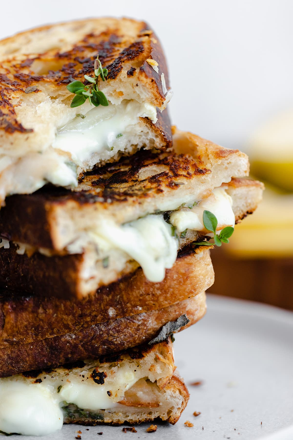 A shot of Goat Grilled Cheese with Pear and Sage