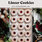 Gluten-Free Linzer Cookies with raspberry jam and a dusting of powdered sugar on a beige plate.