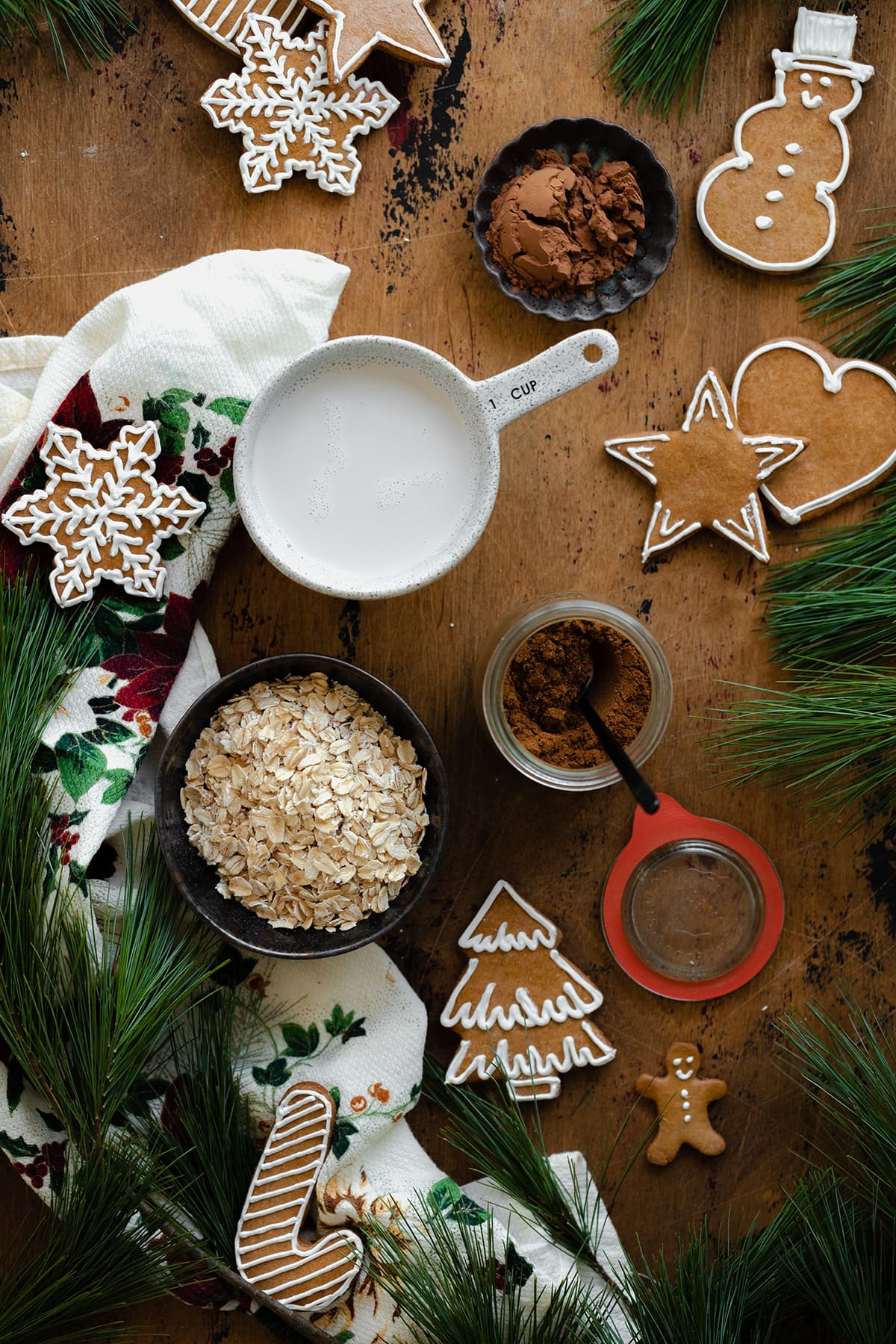 Ingredients for gingerbread oatmeal laid out on a light wooden background.