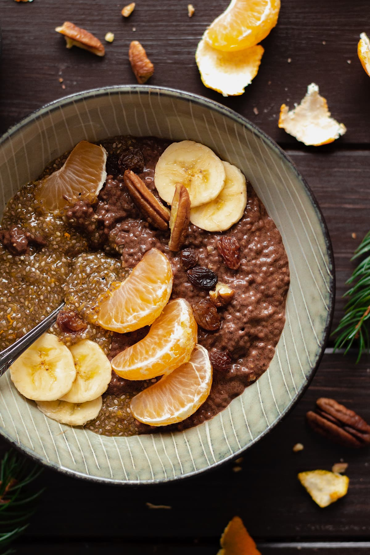 Tangerine Chocolate Chia Pudding in a bowl on a dark wooden table.