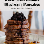 Buckwheat banana blueberry pancakes stacked on a beige plate on a chair.