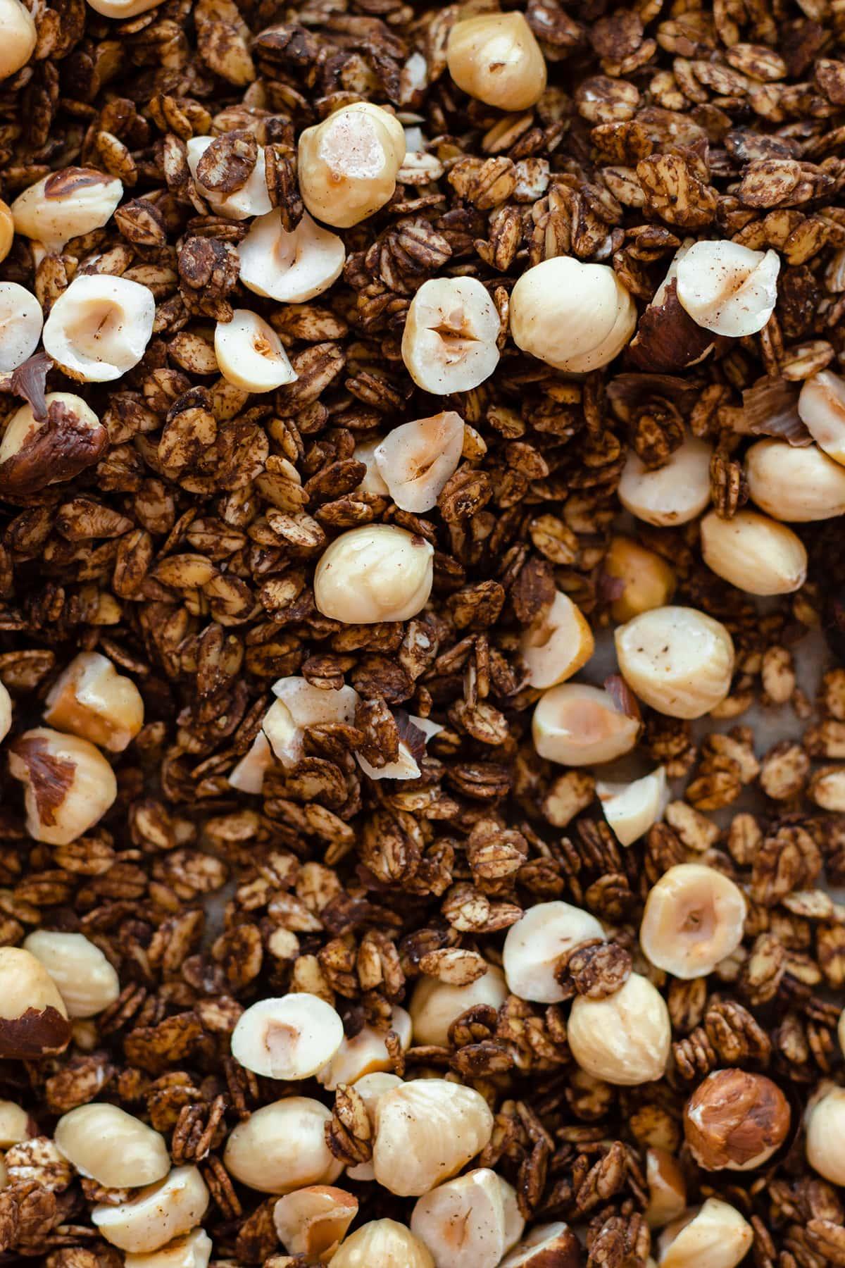 Roasted Hazelnut Carob Granola on a baking sheet - a close up photo.