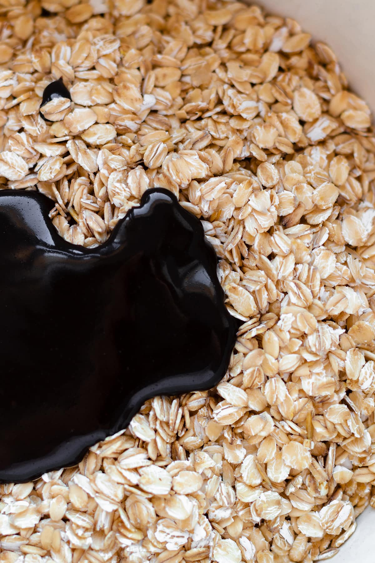 A close up of a bowl with oats and a carob maple syrup and coconut mixture.