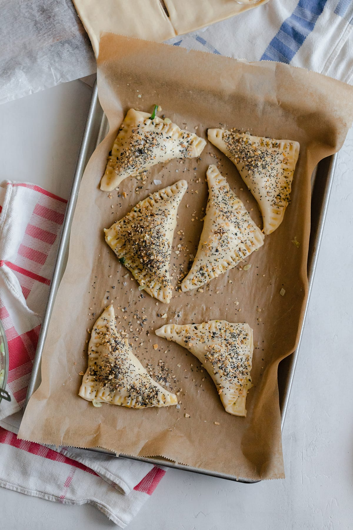 Unbaked Spinach and Feta Puff Pastry Triangles