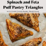 Spinach and Feta Puff Pastry Triangles on parchment paper with the title in the photo.