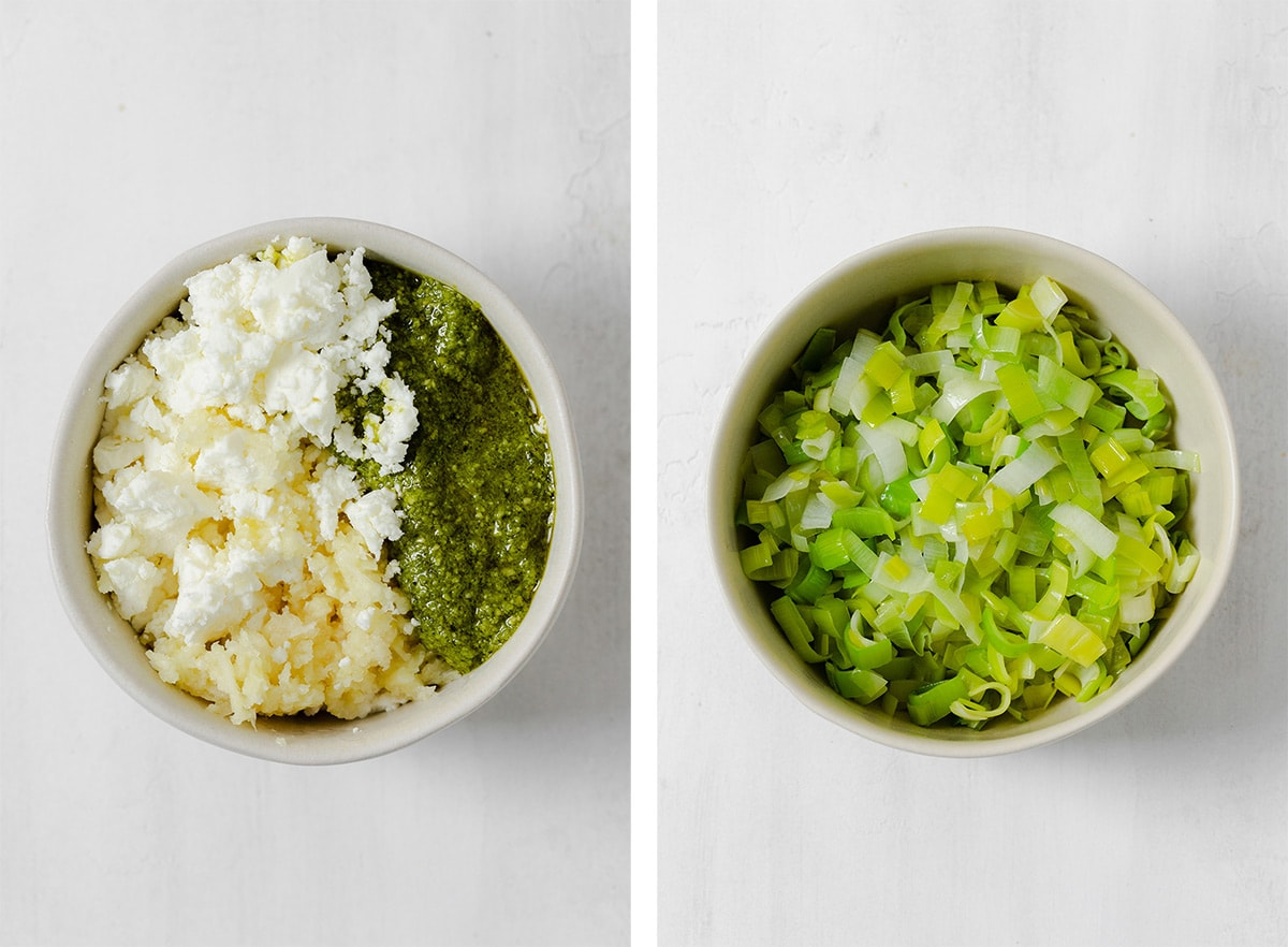 Goat cheese, garlic, and pesto in a bowl on the left, and a bowl of sauteed chopped leek on the right.