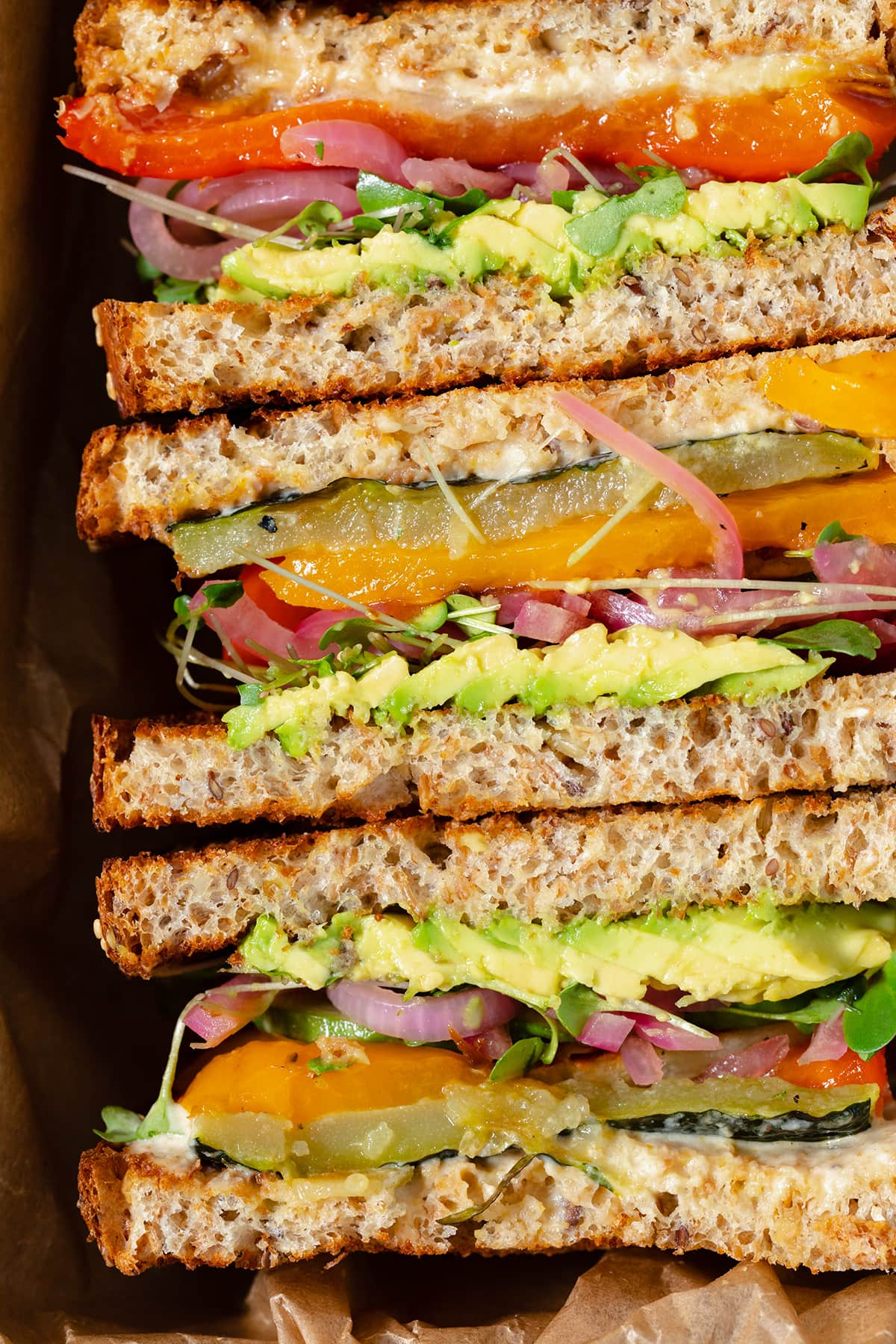 A close up of sandwiches ready to eat. Cut and laid out cut side up.
