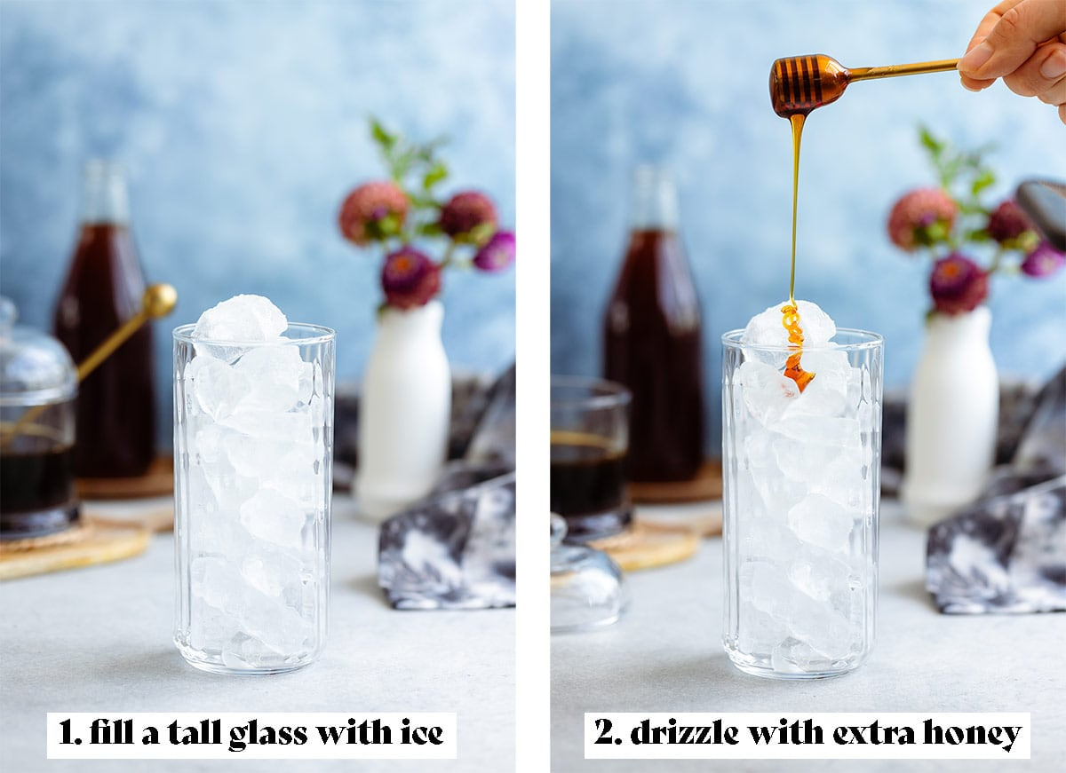 A tall glass filled with ice with a hand drizzling in honey.