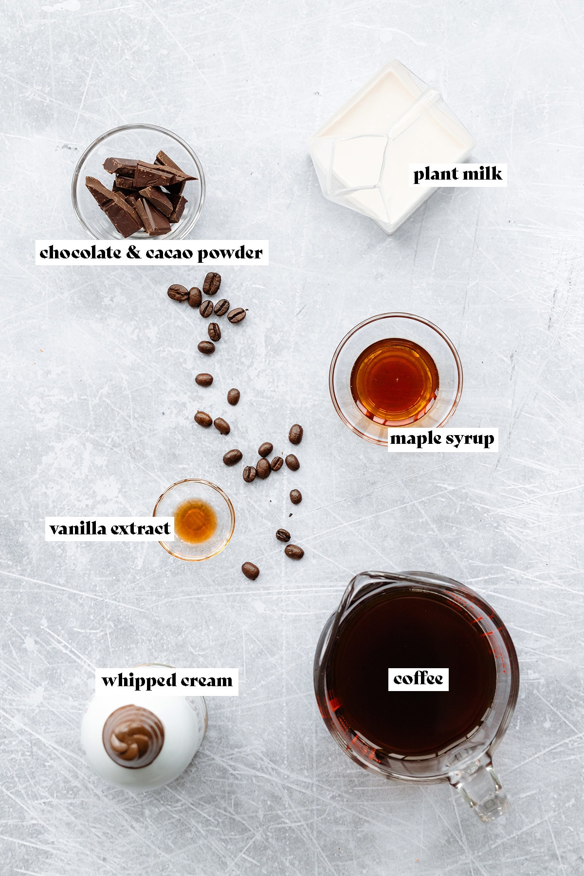 Ingredients needed to make a vegan iced mocha coffee.