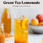 """Iced tea in a tall glass with ice and peach slices on a light grey background with more peaches in a bowl in the back. The text in the photo says """"Iced Peach Green Tea Lemonade Starbucks copycat"""""""