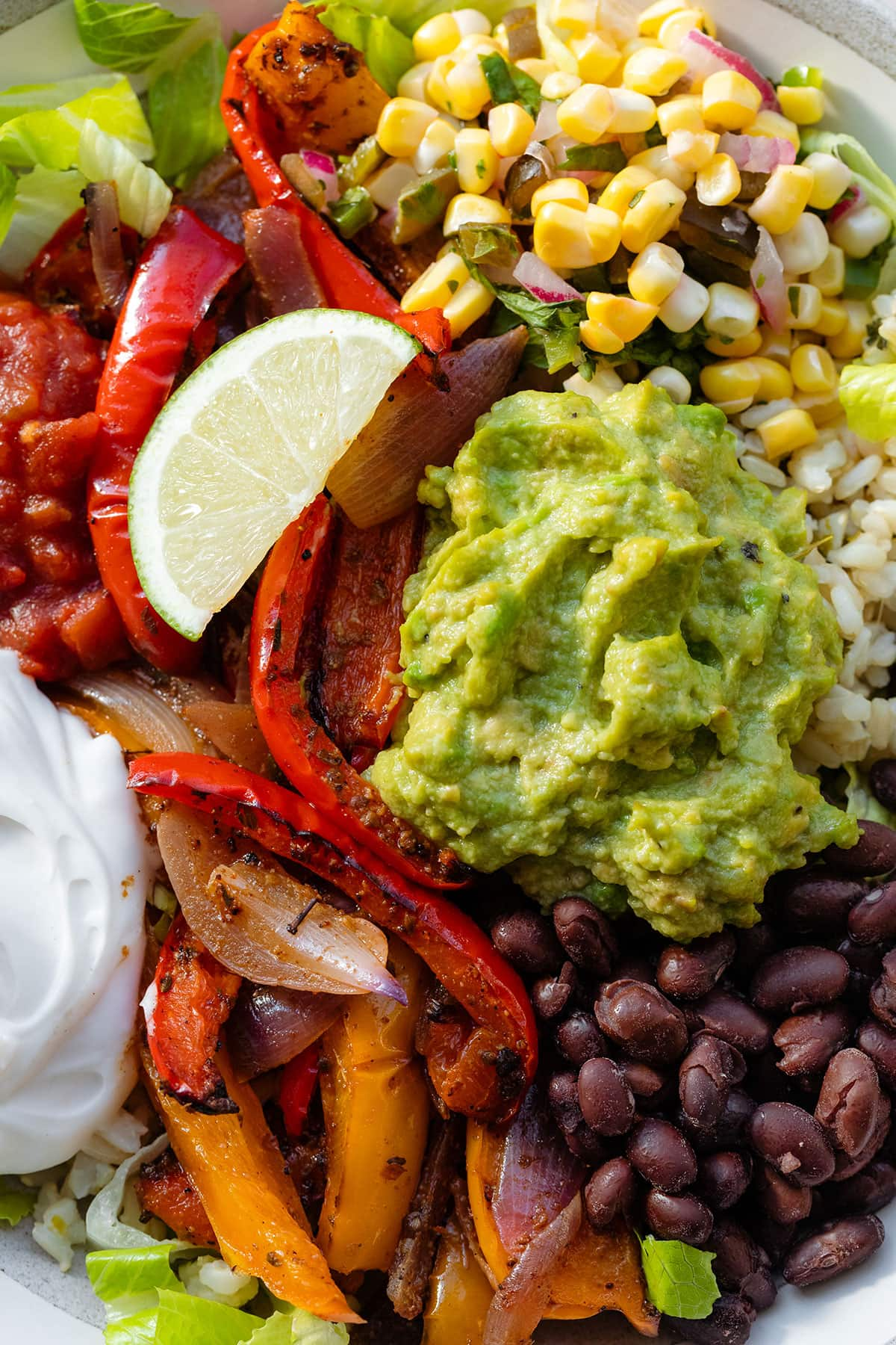 A close up of plated veggie burrito bowl.